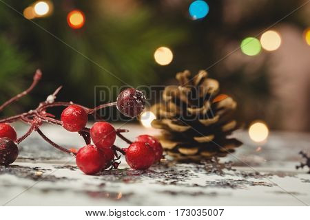 Close-up of christmas ornaments on wooden table during christmas time