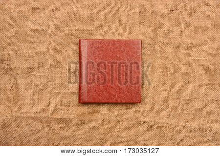 Picture Of Reddish Brown Leather Photo Album Cover On Jute Background. Keeping Memories Alive Throug