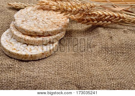 Product Made From Wheat, Expanded And Ears Wheat On O Jute Background. Healthy Organic Food. Selecti