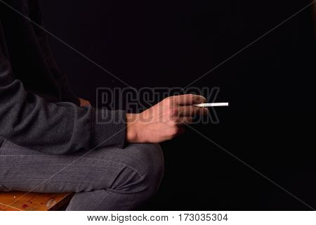 Close Up Of A Teenager Hand Holding A Cigarette. Studio Photo. Harmful Smoking Concept. Unhealthy Ha