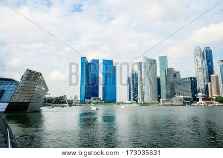 cityscape and skyline of modern city from water in blue cloud sky