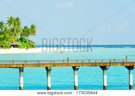 landscape of beautiful tropical sea with bridge in blue sunny sky
