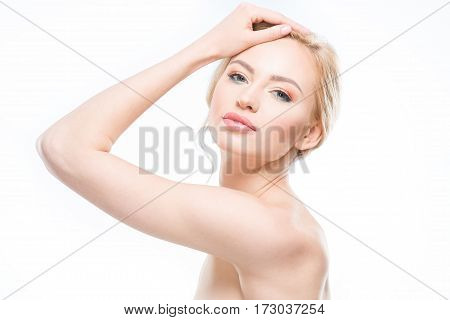 Beautiful blonde woman with stylish makeup posing on white body care concept