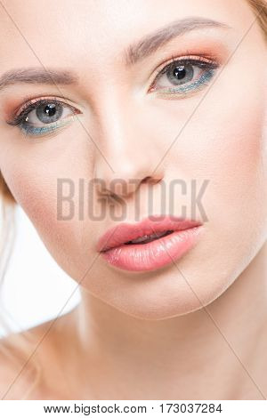 Close-up portrait of young sensual woman with stylish makeup looking at camera skincare concept