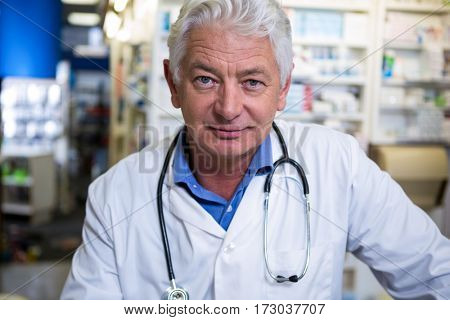 Portrait of pharmacist in lab coat at pharmacy