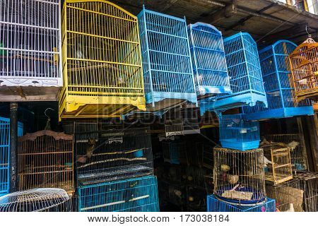 Colourful and beautiful cages made from wood and bamboo sell at traditional animal market photo taken in Depok Indonesia java