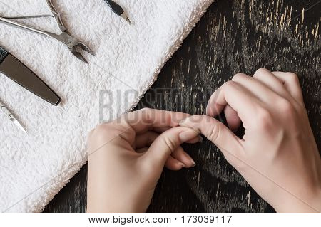 View of beautiful smooth woman's hands with professional nail care tools for manicure
