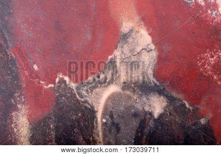 dark red and black jasper texture macro photo