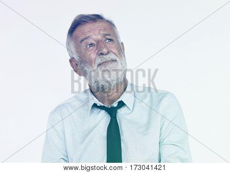 Senior Man Looking Up Face Expression Studio Portrait