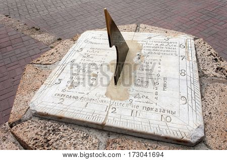 Old Sundial close-up, set in the city of Taganrog, Rostov Region. poster