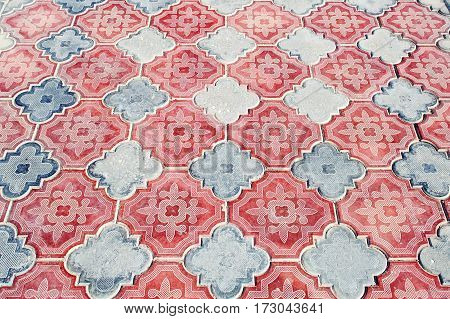 Fragment of old tile and tile pavement surface texture as a background top view horizontal.Egypt.