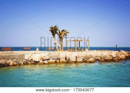 View of a pier with palm trees and the vacation spot. Egipt