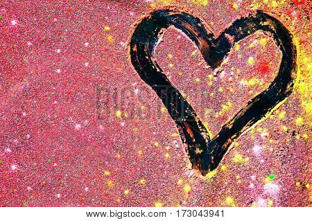 Drawing of heart on the background of colorful powders texture in pink tone.