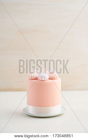 Mini fondant covered cake with meringue kisses