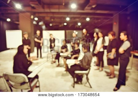 Blurred Image Of Production Team Is Meeting, Sitting And Standing In Production Studio, The Chairman