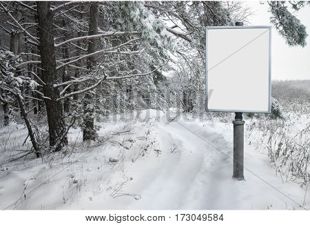 empty billboard for advertising on background snowy forest landscape