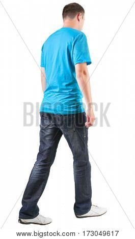 Back view of walking handsome man in t-shirt.   going young guy in jeans  Rear view people collection.  backside view of person.  Isolated over white background.