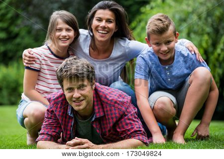 Portrait of happy family smiling in park on a sunny day