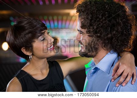 Romantic couple dancing together on dance floor in bar