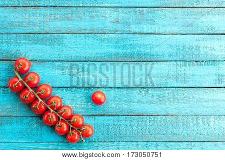 top view of fresh cherry-tomatoes on wooden table