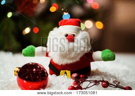 Santa claus and christmas ornaments on snow during christmas time