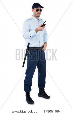 Security officer holding a walkie-talkie against white background