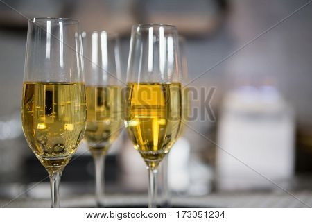 Three glass of champagne on bar counter in bar