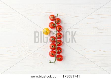 Top view of fresh ripe cherry tomatoes on wooden table