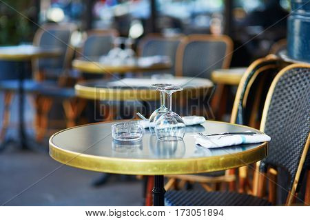 Glasses On A Table Of Cozy Parisian Outdoor Cafe