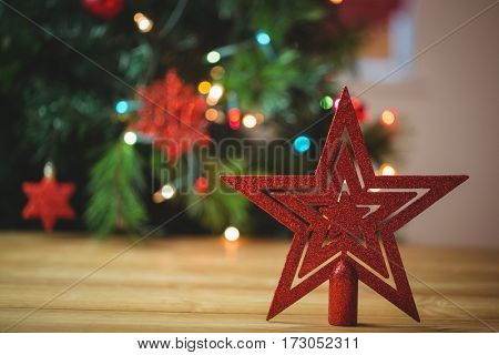 Red star christmas decoration on wooden table