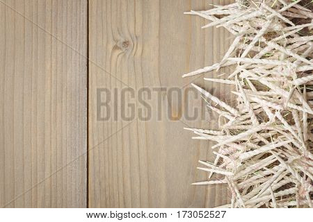 Close-up of mini spiral candle scattered on wooden table