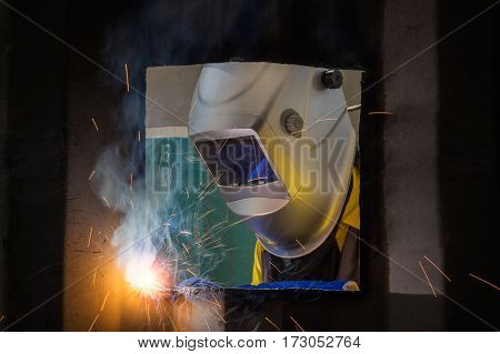 Worker repair the damage container wall Industrial Worker at the factory welding closeup