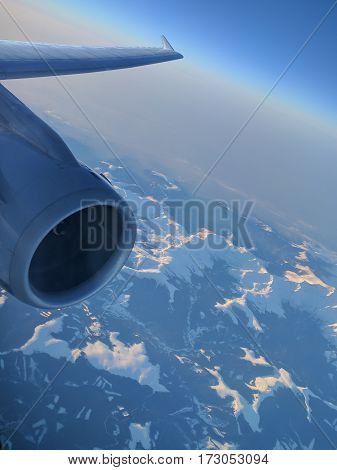 Color image of a plane engine in flight.