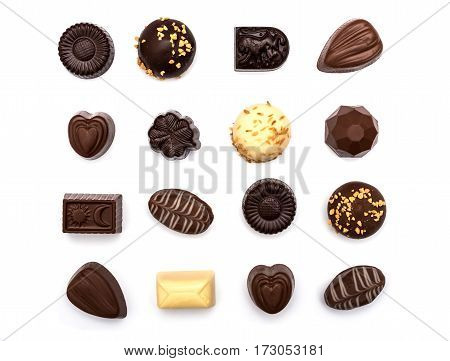 Assorted chocolate candies on a white background