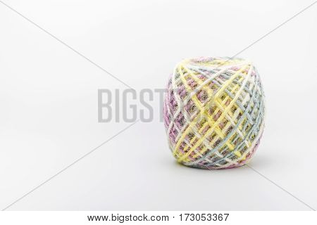 Colorful threads ball for knitting on a white background Copy space.