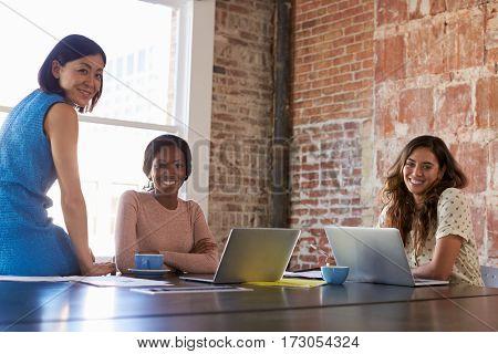 Portrait Of Businesswomen Working Together In Boardroom