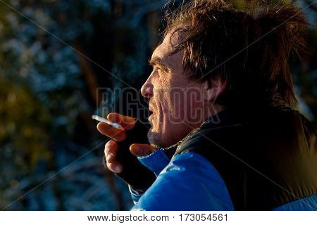 Portrait of middleaged man, smoking a sigarette