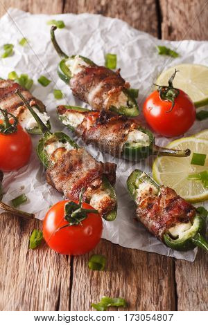 Jalapeno Peppers With Feta Cheese Wrapped In Bacon Close-up. Vertical