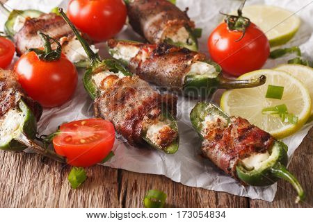Jalapeno Peppers With Feta Cheese Wrapped In Bacon Close-up. Horizontal