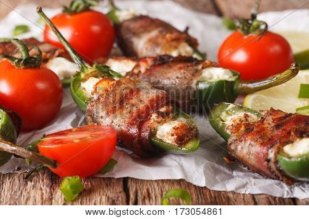 Spicy Appetizer: Jalapeno Peppers Stuffed With Cheese Wrapped In Bacon Close-up. Horizontal
