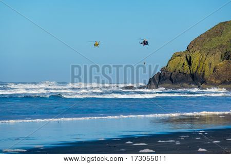 Pacific coast, Cape Disappointment, WA, USA. Coast guard helicopters in the sky.