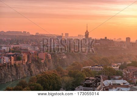 Breathtaking view of Tbilisi and its ancient famous architecture in the sunset, Georgia