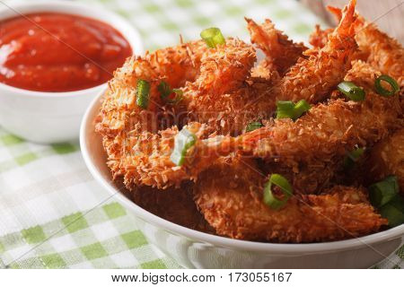 Delicatessen Shrimp In Coconut Breaded Closeup In Bowl And Tomato Sauce. Horizontal