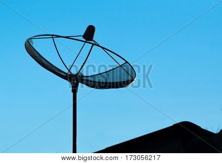 silhouette of satelite dish for television in b;ue sky background