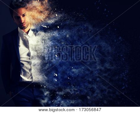 The dispersion effect of a stylish man over a gray background
