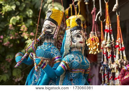 hanging of tradition india doll in display shopfront in Dilli Haat Delhi India. Dilli Haat is traditional marketplace in delhi