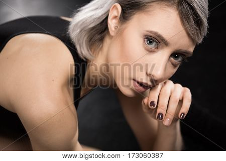 Portrait of attractive young sensual woman posing and looking at camera