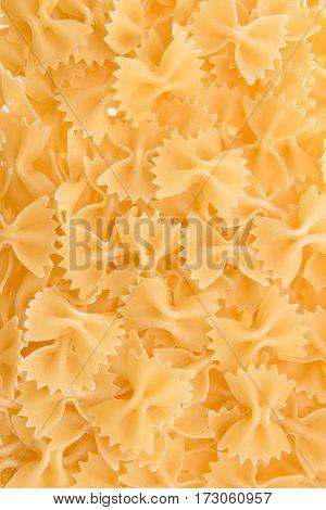 top view of raw macaroni italian pasta as background
