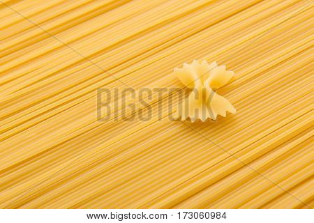 close up view of raw macaroni and vermicelli italian pasta