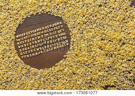 top view of macaroni alphabet and numbers on table